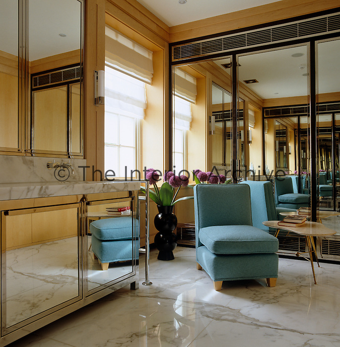 In the bathroom marble floors and mirrored-glass walls have been used to stunning retro effect