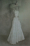 Conceptual image of female wearing white dress 1920's style