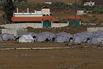 A general view of a refugee camp on the Syrian side of the Israeli-Syrian border, in the Golan Heights near the Syrian village of Aesheh, 27 June 2014. According to UN reports, 9.3 million people in Syria are in need of humanitarian assistance, and more than 2.8 million people have fled to neighboring countries. Photo By: JINIPIX