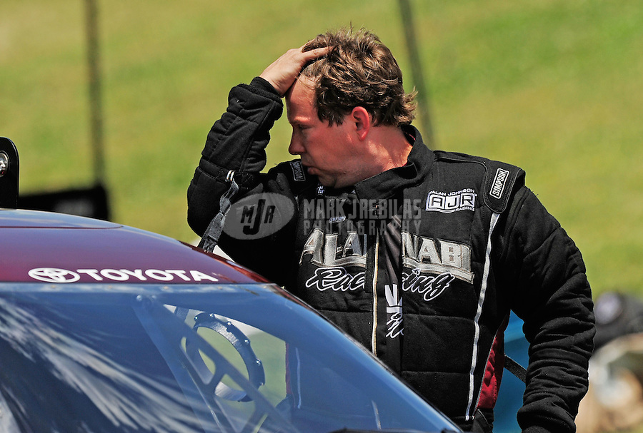 May 31, 2009; Topeka, KS, USA: NHRA funny car driver Del Worsham reacts after losing in the second round during eliminations in the Summer Nationals at Heartland Park Topeka. Mandatory Credit: Mark J. Rebilas-