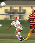 BROOKINGS, SD - AUGUST 23:  Megan Kingston #10 from South Dakota State University centers the ball past Jessica Reyes #13 from Iowa State in the first half of their game Friday evening at Fischback Soccer Field in Brookings. (Photo by Dave Eggen/Inertia)