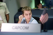 Soyuz 5 Nominated Space Flight Participant Lance Bass, a member of the pop singing group 'N Sync, checks his head set during a familiarization tour of Mission Control Center (MCC) at the Lyndon B. Johnson Space Center in Houston, Texas on August 27, 2002. He is seated at the Spacecraft Communicator (CAPCOM) console in the Station Flight Control Room (BFCR). .Credit: NASA via CNP