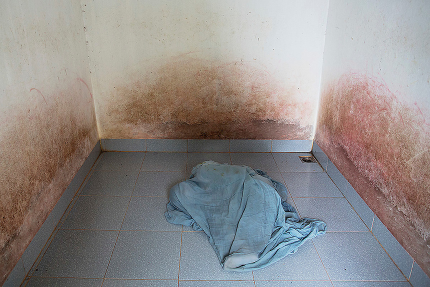 Doan Thi Hong Gam, a 38 year old woman with severe mental and other health problems, covers herself with blanket in an empty room she lives in, in Thai Binh province in northern Vietnam April 10, 2015. The woman with severe mental and other health problems family and health workers believe are linked to the Agent Orange, spends her life in a single room with four bare walls empty of any furniture or other items. She is kept isolated for the last 22 years because of her aggressive and dangerous behaviour linked to mental problems. Doan Thi Hong Gam's father, now suffering from serious heath problems himself, served as a north Vietnamese soldier during the war and said to be exposed to Agent Orange while fighting in the central highlands.  REUTERS/Damir Sagolj