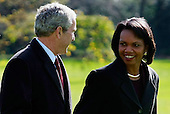 Washington, DC - November 17, 2008 -- United States President George W. Bush (L) walks with Secretary of State Condoleezza Rice after arriving at the White House on Monday, November 17, 2008 in Washington, DC. President Bush was returning from Camp David, the presidential retreat in Maryland.  .Credit: Mark Wilson - Pool via CNP
