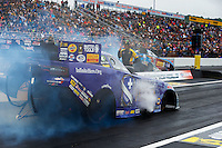 Oct 1, 2016; Mohnton, PA, USA; NHRA funny car driver Jack Beckman (near) does a burnout alongside John Force during qualifying for the Dodge Nationals at Maple Grove Raceway. Mandatory Credit: Mark J. Rebilas-USA TODAY Sports