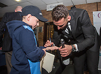MOTM Max Muller of Wycombe Wanderers signs an autograph for a young supporter after the Sky Bet League 2 match between Wycombe Wanderers and Crawley Town at Adams Park, High Wycombe, England on 25 February 2017. Photo by Andy Rowland / PRiME Media Images.