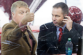 "Don ""Toot"" Cahoon (UMass - Head Coach) communicates with his coach upstairs via hand signals during a goal review while Blaise MacDonald (UMass - Assistant Coach) uses the headset. - The Boston College Eagles defeated the University of Massachusetts-Amherst Minutemen 3-2 to take their Hockey East Quarterfinal matchup in two games on Saturday, March 10, 2012, at Kelley Rink in Conte Forum in Chestnut Hill, Massachusetts."