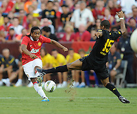 Manchester United midfielder Anderson (8) makes a pass against FC Barcelona midfielder Seydou Keita (15) Manchester United defeated Barcelona FC 2-1 at FedEx Field in Landover, MD Saturday July 30, 2011.