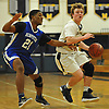 Logan Tucker #12 of Massapequa, right, gets pressured by Amari Spleen #21 of Hempstead during a Nassau County Conference AA-1 varsity boys basketball game at Massapequa High School on Wednesday, Jan. 17, 2018. Massapequa won by a score of 50-44.