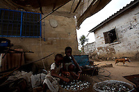 two young girls clean clams  in the Volta region, Ghana, on Saturday March 09 2007..
