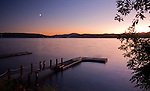 Idaho, North, Coeur d'Alene.The last light of a summer day fades as the moon rises over a canoe and docks on Lake Coeur d'Alene.