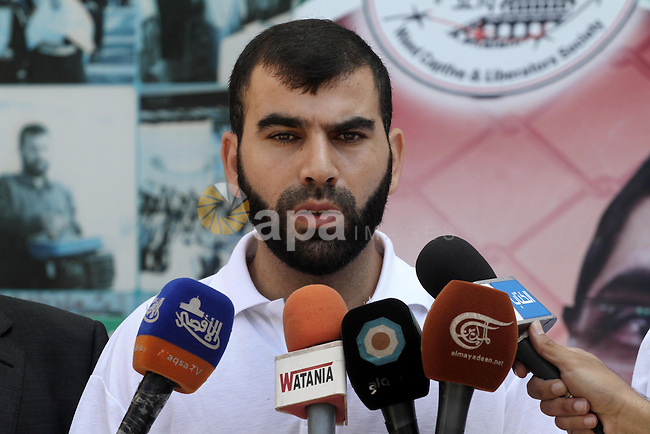 Freed Palestinian prisoner Ayman Abu Daoud speaks during a press conference upon his arrival to the Gaza Strip through Beit Hanoun crossing (Erez), in Gaza City on Aug 22, 2013. Daoud, 37, arrived in the Gaza Strip on Thursday after a deal with Israeli authorities to end a 40-day hunger strike, to be deported to the Gaza Strip after three months. Abu Daoud was freed in a prisoner swap between Israel and Hamas in 2011, but Israel rearrested him in October 2012. Photo by Mohammed Asad