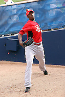 Aroldis Chapman #54 of the Cincinnati Reds warms up in the bullpen prior to his appearance in a spring training game against the Milwaukee Brewers at Maryvale Stadium on March 20, 2011  in Phoenix, Arizona. .Photo by:  Bill Mitchell/Four Seam Images.