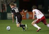 Dax McCarty (10) of D.C. United breaks away from Teemu Tainio (2) of the New York Red Bulls during an MLS match at RFK Stadium, in Washington D.C. on April 21 2011. Red Bulls won 4-0.