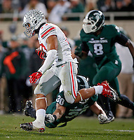 Ohio State Buckeyes running back Jalin Marshall (17) returns a punt and gets past Michigan State Spartans linebacker Riley Bullough (30) during the 2nd quarter at Spartan Stadium in East Lansing, Michigan on November 8, 2014.  (Dispatch photo by Kyle Robertson)