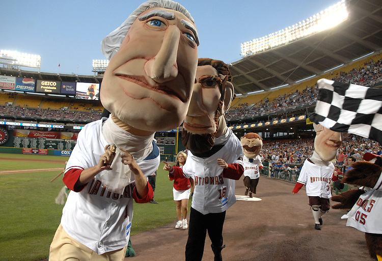 George Washington comes across in first place followed by Abe Lincoln, Thomas Jefferson, and Teddy Roosevelt during the running the President's race in the middle of the fourth inning during the Nationals game at RFK stadium.