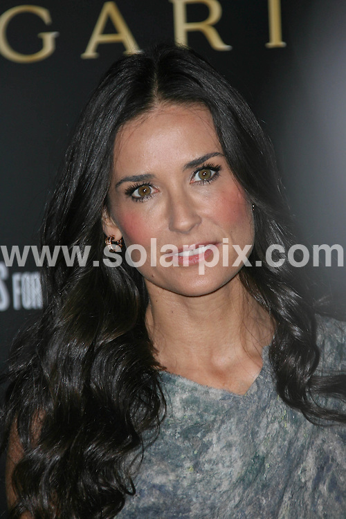 **ALL ROUND PICTURES FROM SOLARPIX.COM**                                             **SYNDICATION RIGHTS FOR UK, AUSTRALIA, DENMARK, PORTUGAL, S. AFRICA, SPAIN & DUBAI (U.A.E) & ASIA (EXCLUDING JAPAN) ONLY**                                                                                  Caption:  Arrivals at the Bvlgari Private Event honouring Simon Fuller and Paul Haggis to Benefit Save the Children and Artists for Peace and Justice, held at the Ron Burkle Residence, Beverly Hills, USA. 13 January 2011                                                                    This pic: Demi Moore                                                                                       JOB REF: 12666 PHZ Charlotte      DATE: 13_01_2011                                                           **MUST CREDIT SOLARPIX.COM OR DOUBLE FEE WILL BE CHARGED**                                                                      **MUST AGREE FEE BEFORE ONLINE USAGE**                               **CALL US ON: +34 952 811 768 or LOW RATE FROM UK 0844 617 7637**