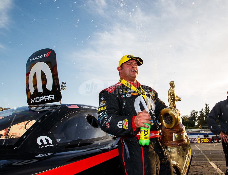 Feb 11, 2018; Pomona, CA, USA; NHRA funny car driver Matt Hagan celebrates after winning the Winternationals at Auto Club Raceway. Mandatory Credit: Mark J. Rebilas-USA TODAY Sports