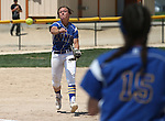 Wildcats' shortstop Makaylee Jaussi makes a throw to Katilyn Covione during a game against College of Southern Nevada at Edmonds Sports Complex Carson City, Nev., on Saturday, May 2, 2015.<br /> Photo by Cathleen Allison