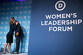 """United States President Barack Obama greets U.S. Representative Debbie Wasserman Schultz (Democrat of Florida), Chairwoman of the Democratic National Committee (DNC), before speaking at the DNC's annual Women's Leadership Forum in Washington, D.C., U.S., on Friday, September 19, 2014. Speaking at an event today at the White House, President Obama rolled out the """"It's On Us"""" campaign to encourage college students, especially men, to speak out against and prevent sexual assault on campuses. <br /> Credit: Andrew Harrer / Pool via CNP"""