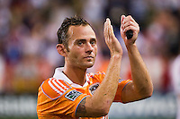 Brad Davis (11) of the Houston Dynamo salutes the fans after the game.. The New York Red Bulls defeated the Houston Dynamo 2-0 during a Major League Soccer (MLS) match at Red Bull Arena in Harrison, NJ, on August 10, 2012.