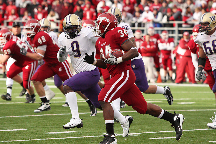 "Logwone Mitz (#34), Washington State University running back, turns the corner with the University of Washington's Donald Butler (#9) in hot pursuit during the ""Apple Cup"" football game on November 22, 2008, at Martin Stadium in Pullman, Washington.  The Cougars beat the Huskies in their annual rivalry 16-13 in a double overtime thriller."