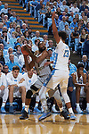 Keyshawn Woods (1) of the Wake Forest Demon Deacons is guarded by Cameron Johnson (13) of the North Carolina Tar Heels during first half action at the Dean Smith Center on December 30, 2017 in Chapel Hill, North Carolina.  The Tar Heels defeated the Demon Deacons 73-69.  (Brian Westerholt/Sports On Film)