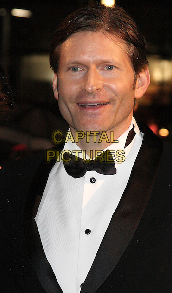 CRISPIN GLOVER .World Premiere of 'Alice In Wonderland' at the Odeon, Leicester Square, London, England..February 25th, 2010.headshot portrait black white bow tie mouth open.CAP/ROS.©Steve Ross/Capital Pictures.