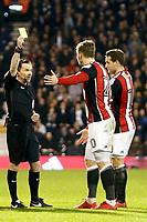 Lee Evans of Sheffield United is booked by referee, Keith Stroud during the Sky Bet Championship match between Fulham and Sheff United at Craven Cottage, London, England on 6 March 2018. Photo by Carlton Myrie.