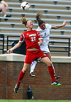WINSTON-SALEM, NORTH CAROLINA - September 01, 2013:<br /> Katie Walz (27) of Louisville University goes up for a header against Jenai Davidson (5) of Wake Forest University during a match at the Wake Forest Invitational tournament at Wake Forest University on September 01. The match was abandoned early in the second half due to severe weather with Wake leading 1-0.