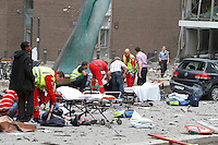 (July22,2010)Two men are treated for injuries received after a large vehicle bomb was detonated near the offices of Norwegian Prime Minister Jens Stoltenberg on 22 July 2011. Although Stoltenberg was reportedly unharmed the blast resulted in several injuries and deaths. <br /> Another terrorist attack took place shortly afterwards, where a man killed over 80 children and youths attending a political camp at Ut&oslash;ya island. <br /> Anders Behring Breivik was arrested on the island and has admitted to carrying out both attacks.<br /> (photo:Fredrik Naumann/Felix Features)
