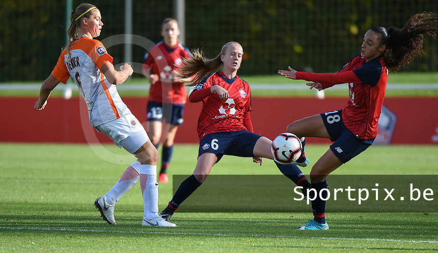 20181027 - CAMPHIN-EN-PEVELE , FRANCE : LOSC's Silke Demeyere (M) and Lina Boussaha (R) with Montpellier's Anouk Dekker (L) pictured during the 8 th competition game between the women teams of Lille OSC and Montpellier Herault Sporting Club in the 2018-2019 season of the first Division - Ligue 1 at Domaine de Luchin , Saturday 27th Octobre 2018 ,  PHOTO Dirk Vuylsteke | Sportpix.Be