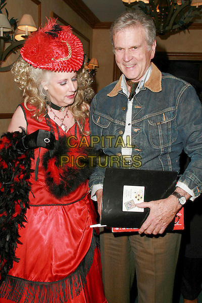 DEBORAH DURDEN & DON MURRAY.9th Annual Silver Spur Awards The Reel Cowboys held at Sportmans Lodge, Studio City, California, USA, .20 October 2006..half length black and red dress hat featehr bower costume fancy dress.Ref: ADM/CH.www.capitalpictures.com.sales@capitalpictures.com.©Charles Harris/AdMedia/Capital Pictures.