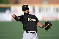 First baseman Onil Pena (32) of the West Virginia Power warms up before a game against the Greenville Drive on Friday, May 17, 2019, at Fluor Field at the West End in Greenville, South Carolina. West Virginia won, 10-4. (Tom Priddy/Four Seam Images)