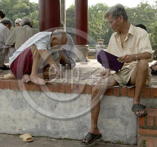 Hanoi-Vietnam, Ha Noi - Viet Nam - 21 July 2005---Men playing a board game at Ngoc Son (Jade Mountain) Temple on Hoan Kiem Lake---culture, people---Photo: Horst Wagner/eup-images