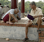 Hanoi-Vietnam, Ha Noi - Viet Nam - 21 July 2005---Men playing a board game at Ngoc Son (Jade Mountain) Temple on Hoan Kiem Lake---culture, people---Photo: Horst Wagner/eup-images