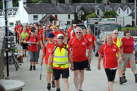 25-7-2014: Kerry legend and Breakthrough Cancer Research ambassador Pat Spillane is pictured with Pat Murray and Anne O'Sullivan with some of those walking the 3 day Kerry Way Walk for Cancer Research at Kenmare Pier on Friday on day 1 of the three day event which will take walkers through some of the most scenic parts of South Kerry.<br /> Picture by Don MacMonagle<br /> <br /> repro free photo<br /> <br /> press release:<br /> 9th Kerry Way Cancer Research Gets Under Way <br /> Organisers hope to raise &euro;50k for cancer research projects Hundreds of walkers have descended on the Kingdom for the 9th annual Kerry Way Cancer Research walk in aid of Breakthrough Cancer Research who fund cancer research programmes administered by Cork Cancer Research Centre. <br /> <br /> The Kerry Way Cancer Research walk is a guided 70km walk over three days combining impressive mountain views, dramatic peaks and glens, wild moorlands, wooded paths and lakes along the Kerry Way trails.  Challenging but fun, the great camaraderie on the route adds to the spectacular settings and ensures a truly memorable experience in the Kingdom.  <br /> Kerry footballing legend and Breakthrough Cancer Research ambassador, Pat Spillane was on hand to wave the walkers off on their trek.  The walks over the three days include some of Irelands most fabulous walk ways Lauragh to Kenmare incorporating part of The Beara Way, Lough Inchiquin the Torc Waterfall and Esknamucky Glen, this year&rsquo;s walk features the added element of a twilight boat trip on Friday evening across the beautiful Kenmare Bay, landing at Templenoe to start the walk to Kenmare.  <br /> <br /> Speaking at the starting point Orla Dolan, Breakthrough Cancer Research Fundraising Manager said &ldquo;The Kerry Way Cancer Research Walk has gone from strength to strength raising over &euro;650,000 for cancer research in the past nine years. Today&rsquo;s walk turnout is testament to the popularity of the walk and also all the lives cancer effects, people want to play their part in the fight against cancer and we are delight