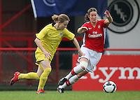 Ciara Grant of Arsenal keeps an eye on Katerina Doskova - Arsenal Ladies vs Sparta Prague - UEFA Women's Champions League at Boreham Wood FC - 11/11/09 - MANDATORY CREDIT: Gavin Ellis/TGSPHOTO - Self billing applies where appropriate - Tel: 0845 094 6026