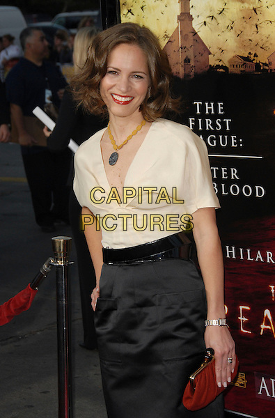 "SUSAN DOWNEY .The Warner Brothers' Pictures L.A. Premiere of ""The Reaping"" held at The Mann Village Theatre in Westwood, California, USA. .March 29th, 2007.half length black skirt white cream top blouse .CAP/DVS.©Debbie VanStory/Capital Pictures"
