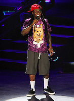 IRVINE, CA - SEPTEMBER 01: Rapper Lil Wayne performs during the America's Most Wanted Music Festival 2013 at the Verizon Wireless Amphitheater on September 1, 2013 in Irvine, California. (Photo by Xavier Collin/Celebrity Monitor)