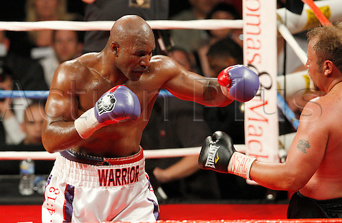 10/04/2010 Evander Holyfield in action against South African Frans Botha in a heavyweight fight at Thomas & Mack Center in Las Vegas, Nevada. The 47 year old Holyfield scored an eighth round TKO to win the WBF heavyweight title.