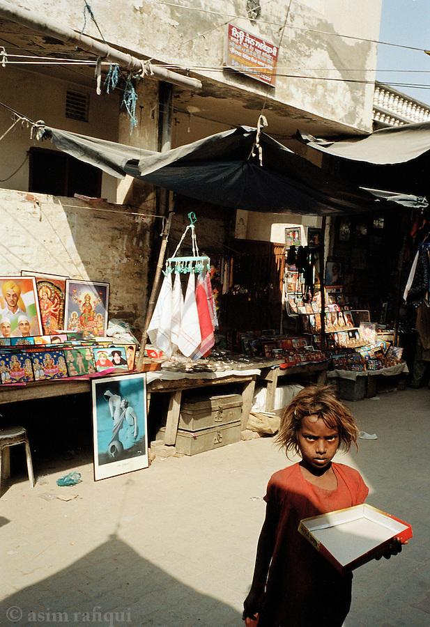 A child sells souvenirs outside the shrine to Baba Farid