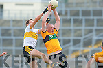 Stack's Kieran Donaghy wins this aerial dual against Eoin Brosnan during the quarter final dual in Fitzgerald Stadium on Sunday