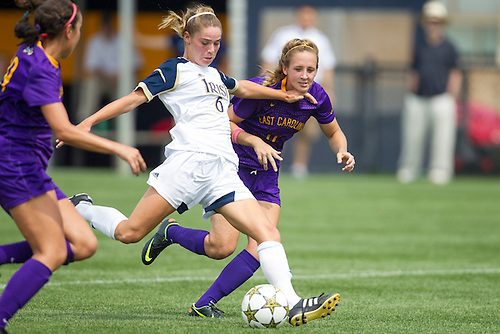 August 26, 2012:  Notre Dame forward Anna Maria Gilbertson (6) shoots the ball as East Carolina Haley Patsey (11) defends  during NCAA Soccer match between the Notre Dame Fighting Irish and the East Carolina Pirates at Alumni Stadium in South Bend, Indiana.  Notre Dame defeated East Carolina 5-0.