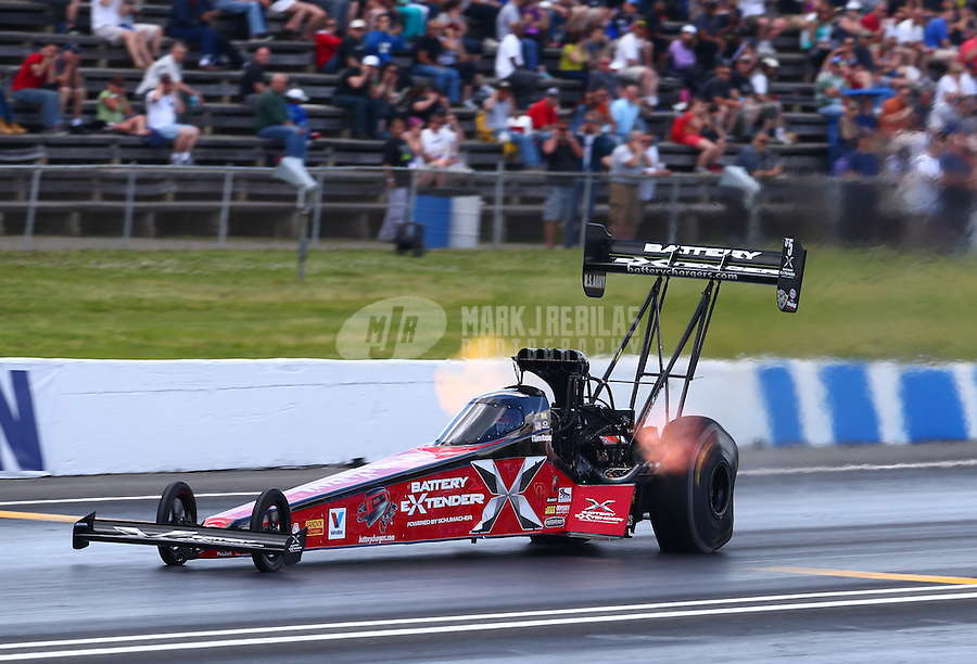 May 31, 2014; Englishtown, NJ, USA; NHRA top fuel driver Spencer Massey during qualifying for the Summernationals at Raceway Park. Mandatory Credit: Mark J. Rebilas-