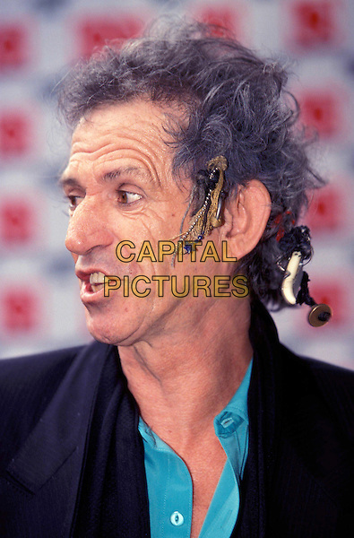 THE ROLLING STONES - KEITH RICHARDS..Ref: 9037..hair accessories, portrait headshot, turquoise shirt, black blazer..www.capitalpictures.com..sales@capitalpictures.com