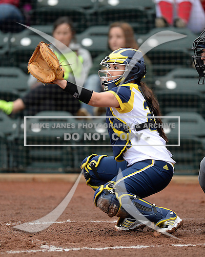 Michigan Wolverines catcher Lauren Sweet (25) during the season opener against the Florida Gators on February 8, 2014 at the USF Softball Stadium in Tampa, Florida.  Florida defeated Michigan 9-4 in extra innings.  (Copyright Mike Janes Photography)