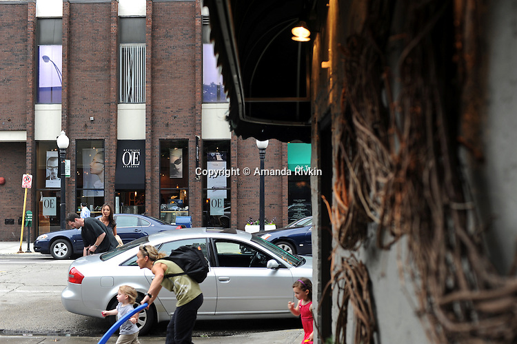 Pedestrians are seen on North Wells Street, the main shopping thoroughfare in Old Town, in Chicago, Illinois on June 19, 2009.