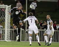 Blake Brettechneider(29) of D.C. United heads past Brian Carroll(7) of the Philadelphia Union during a play-in game for the US Open Cup tournament at Maryland Sportsplex, in Boyds, Maryland on April 6 2011. D.C. United won 3-2 after overtime penalty kicks.