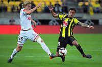Ben Halloran (left) and Tom Doyle compete for the ball during the A-League football match between Wellington Phoenix and Adelaide United at Westpac Stadium in Wellington, New Zealand on Saturday, 24 November 2018. Photo: Dave Lintott / lintottphoto.co.nz
